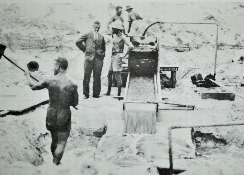 Sluicing black sand to recover gold at Seven Mile Beach – 1935. Morley Photo