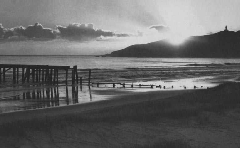 Sunrise over the old jetty late 1930's EJW photo RTRL