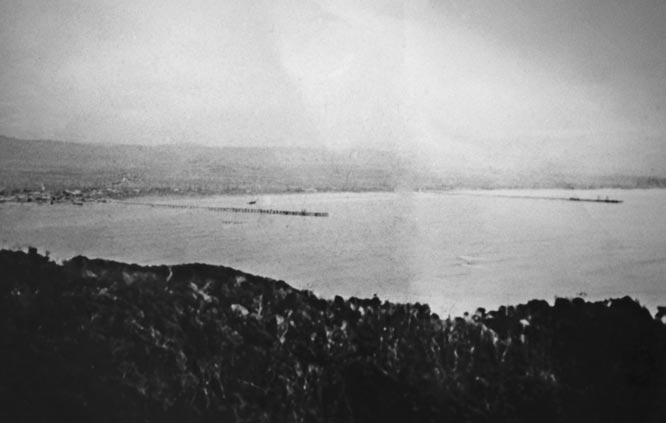 The Old and New Jetties Viewed from Cape Byron - 1930's. EJW Photo – RTRL