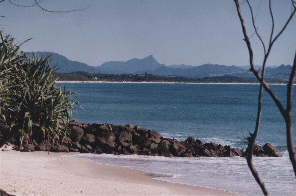 The view to Mt Warning across the broad sandy Byron Bay. EJW Photo – RTRL